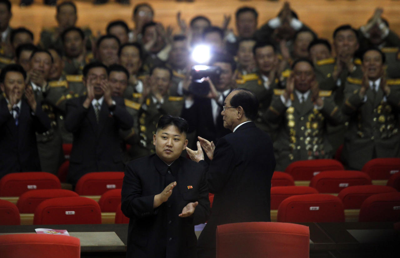"""North Korea's leader Kim Jong Un applauds as he walks ahead of Kim Yong Nam, president of the Presidium of the Supreme People's Assembly after attending a concert to mark the 80th anniversary of the founding of the North Korean army in Pyongyang, North Korea, Wednesday, April 25, 2012.  North Korea is armed with """"powerful modern weapons"""" capable of defeating the United States, a top military chief in Pyongyang said Wednesday, a claim that matches the country's regular rhetoric but is questioned by experts.  (AP Photo/Ng Han Guan)"""