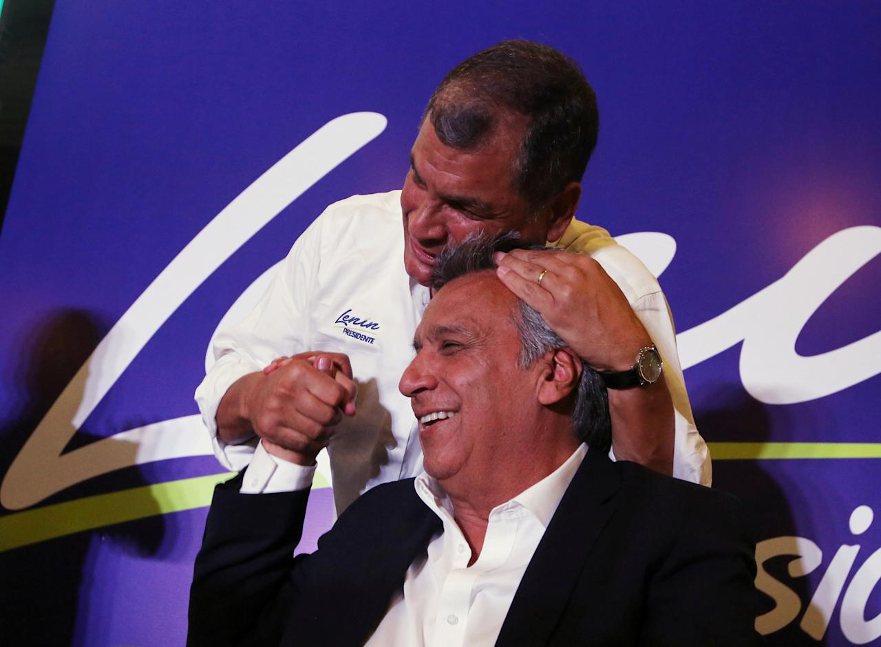 Ecuador's President Rafael Correa (top) hugs Lenin Moreno, candidate of the ruling PAIS Alliance Party, at the Hotel Colon during the presidential election in Quito, Ecuador February 19, 2017. REUTERS/Mariana Bazo