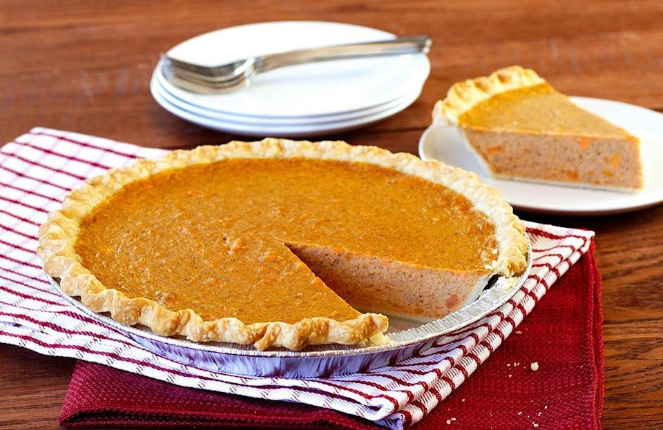 "<p>While you may be used to sweet potatoes being served as a side dish during <a href=""https://www.thedailymeal.com/recipes-weeknight-dinners-simple?referrer=yahoo&category=beauty_food&include_utm=1&utm_medium=referral&utm_source=yahoo&utm_campaign=feed"" rel=""nofollow noopener"" target=""_blank"" data-ylk=""slk:weeknight dinners"" class=""link rapid-noclick-resp"">weeknight dinners</a>, in North Carolina the veggie shines when baked into pie. North Carolina has been the No. 1 sweet potato producing state in the U.S. for nearly 50 years.</p> <p><a href=""https://www.thedailymeal.com/recipes/sweet-potato-pie-recipe-0?referrer=yahoo&category=beauty_food&include_utm=1&utm_medium=referral&utm_source=yahoo&utm_campaign=feed"" rel=""nofollow noopener"" target=""_blank"" data-ylk=""slk:For the Sweet Potato pie recipe, click here"" class=""link rapid-noclick-resp"">For the Sweet Potato pie recipe, click here</a>.</p>"