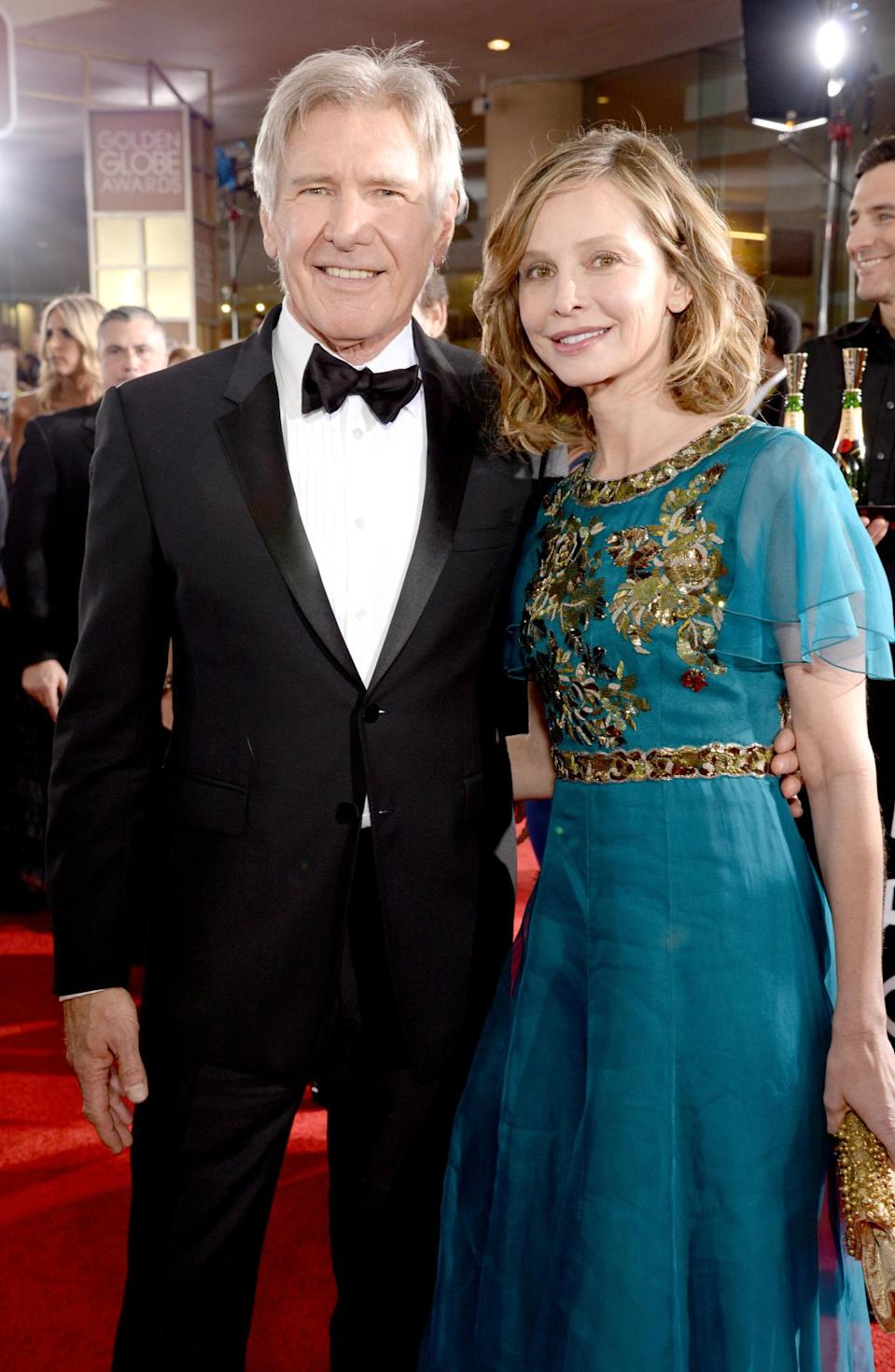 """<p>The couple originally met at the 2002 Golden Globe Awards, so their appearance at this year's event was an anniversary of sorts. They eloped in 2010 with her son Liam in attendance (but not Ford's four children from his previous marriage to late screenwriter Melissa Mathison). Ford gushed to <i>People </i>in 2003 about her support of his hobby; flying: """"Calista loves to fly, and I'm thrilled because it's so important to me and it's the kind of thing that's so much more fun with somebody who really enjoys it."""" It turns out, however, that flying may be a bigger issue for the couple than their 22-year age difference. Ford has had three plane crashes during their 14 years together. <i>(Photo: Getty Images)</i></p><p><i><br></i></p>"""
