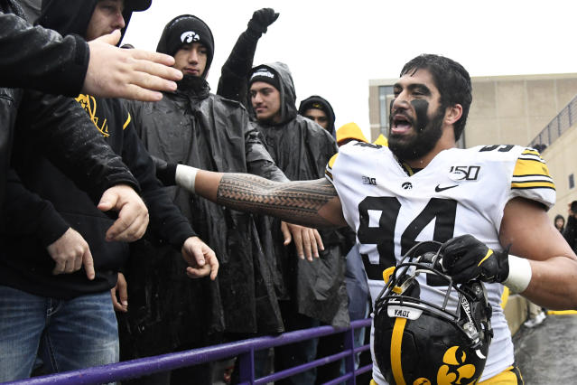 FILE - In this Oct. 26, 2019, file photo, Iowa defensive end A.J. Epenesa (94) celebrates his teams 20-0 win against Northwestern in an NCAA college football game in Evanston, Ill. Epenesa was selected to The Associated Press All-Big Ten Conference team, Wednesday, Dec. 11, 2019. (AP Photo/David Banks, File)