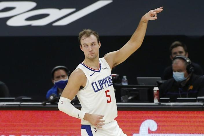 Clippers guard Luke Kennard gestures after making a three-point shot against the Suns on Jan. 3, 2021, in Phoenix.