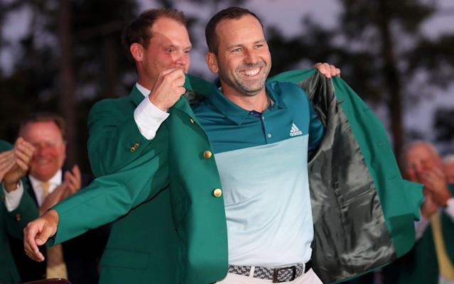 Danny Willett presents Sergio Garcia with the green jacket - Getty Images North America