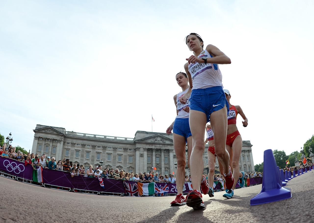 LONDON, ENGLAND - AUGUST 11:  Anisya Kirdyapkina of Russia and Elena Lashmanova of Russia compete during the Women's 20km Walk final on Day 15 of the London 2012 Olympic Games on the streets of London on August 11, 2012 in London, England.  (Photo by Harry How/Getty Images)
