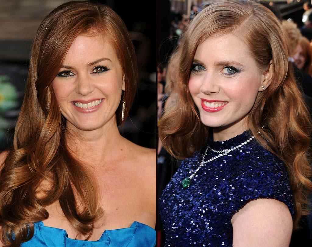 "Finally, it's the battle of the fierce redheads: funny girl Isla Fisher and -- are we the only one who sometimes mixes the two up? -- Academy Award nominee Amy Adams. We have to admit that both look lovely with their long, tousled locks, but for us, it's Amy all the way! Do you find ""The Fighter"" actress fab, too? <a href=""http://www.wireimage.com"" target=""new"">WireImage.com</a> - March 1, 2011"