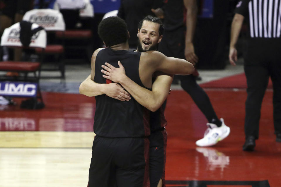 San Diego State's Jordan Schakel (20) and Matt Mitchell (11) celebrate after defeating UNLV during an NCAA college basketball game Wednesday, March 3, 2021, in Las Vegas. (AP Photo/Joe Buglewicz)