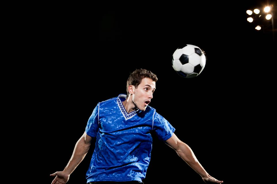 Repeatedly 'heading' a football is increasingly being linked to dementia. (Posed by a model, Getty Images)