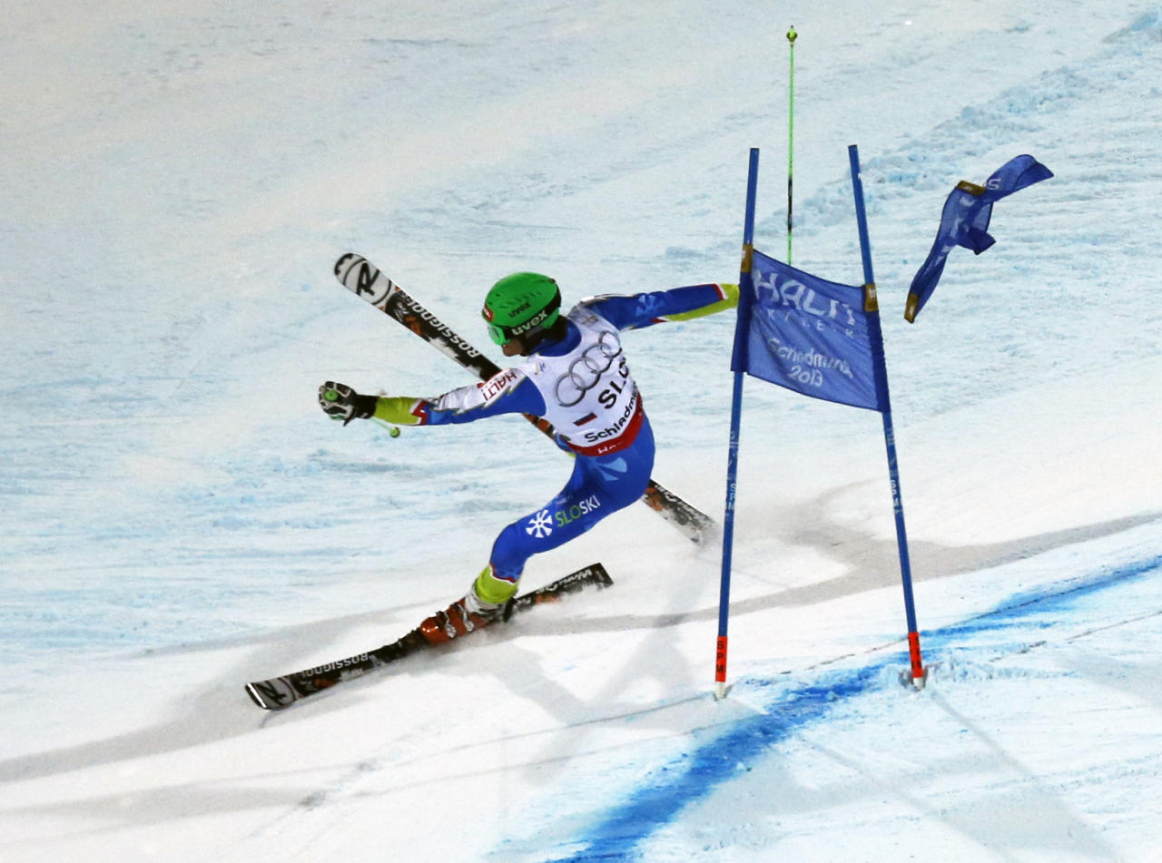 Misel Zerak of Slovenia crashes after a gate flag flies away from his face after skiing through it during the national team event at the World Alpine Skiing Championships in Schladming February 12, 2013.    REUTERS/Leonhard Foeger (AUSTRIA  - Tags: SPORT SKIING)   - RTR3DOWR
