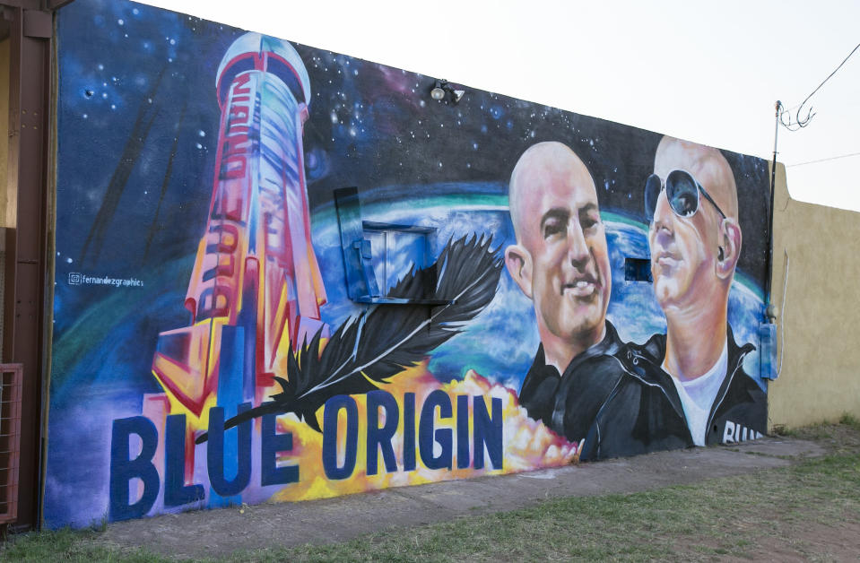 A mural by Fernandezgraphics of Blue Origin and Amazon founder Jeff Bezos is seen on the wall of a building Tuesday in Van Horn, Texas. Bezos has blasted into space on his rocket company's first flight with passengers. He's the second billionaire in just over a week to ride his own spacecraft. The Amazon founder rode to space with a hand-picked group and their Blue Origin capsule landed 10 minutes later on the desert floor in West Texas. (Jacob Ford/Odessa American via AP)