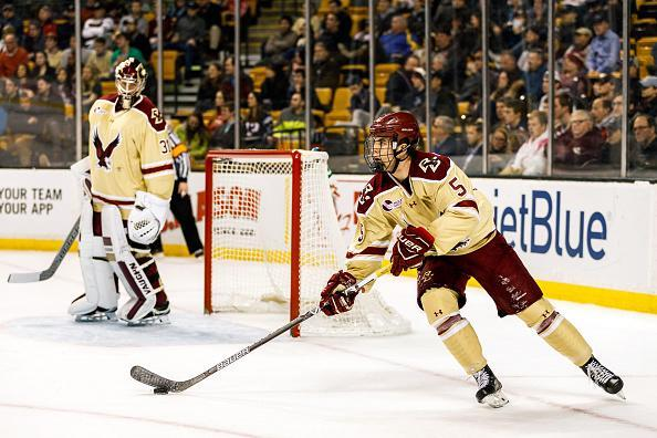"BOSTON, MA – FEBRUARY 06: <a class=""link rapid-noclick-resp"" href=""/ncaab/teams/bam/"" data-ylk=""slk:Boston College Eagles"">Boston College Eagles</a> defenseman Casey Fitzgerald (5) skates with the puck to start a play during the first period of the Beanpot Tournament semifinals game between the Boston University Terriers and the Boston College Eagles on February 6th, 2017 at TD Garden in Boston, MA. (Photo by John Kavouris/Icon Sportswire via Getty Images)"