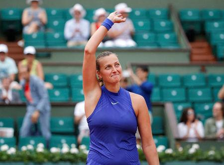Tearful Kvitova returns, Kerber in historic loss