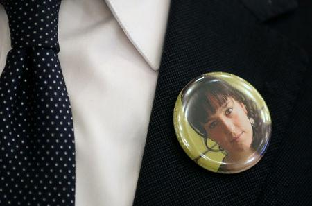 "The co-plaintiff Paco (Francisco) Zapater from Spain wears a badge with a picture of his late daughter Clara during the trial of the organizers of the 2010 ""Love Parade"" festival, where 21 people were killed in a stampede in Duesseldorf, Germany, December 8, 2017. REUTERS/Ina Fassbender/POOL"