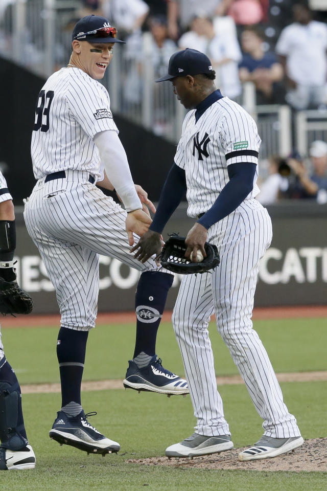 New York Yankees right fielder Aaron Judge, left, and relief pitcher Aroldis Chapman celebrate after their 12-8 win during a baseball game in London, Sunday, June 30, 2019. (AP Photo/Tim Ireland)