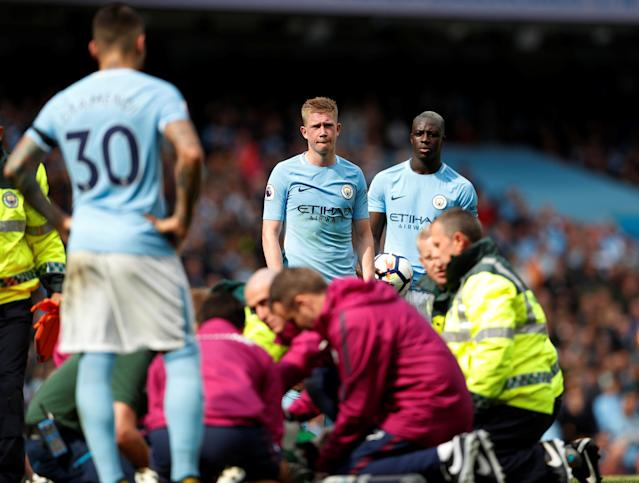 <p>Manchester City's Ederson Moraes receives medical attention as Kevin De Bruyne and Benjamin Mendy look on A </p>