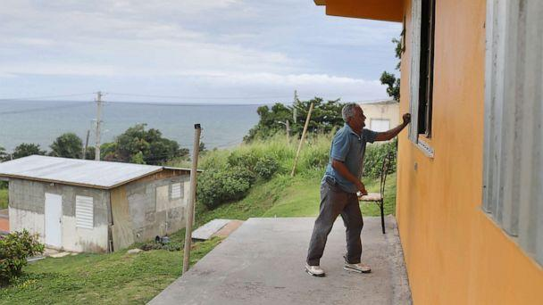 PHOTO: Zollo Azea puts shutters over the windows of his home as he prepares for the arrival of Tropical Storm Dorian on Aug. 28, 2019, in Yabucoa, Puerto Rico. (Joe Raedle/Getty Images)