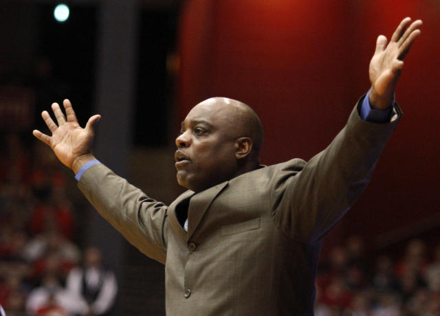Delaware State head coach Greg Jackson getures in the first half of an NCAA college basketball game against Dayton, Wednesday, Dec. 4, 2013, in Dayton, Ohio. (AP Photo/Skip Peterson)