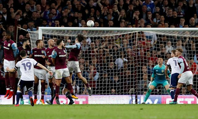 Stewart Downing's free-kick from the edge of the penalty area beats the Aston Villa wall but went on to hit the bar.