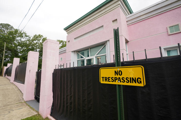 """The Jackson Women's Health Organization clinic, also more commonly known as """"The Pink House,"""" is shrouded with a black tarp so that its clients may enter in privacy, Wednesday, May 19, 2021, in Jackson, Miss. The Supreme Court agreed to take up a dispute over a Mississippi ban on abortions after 15 weeks of pregnancy, with their decision affecting whether the state's only medical facility will continue to be able to provide abortions on demand. (AP Photo/Rogelio V. Solis)"""