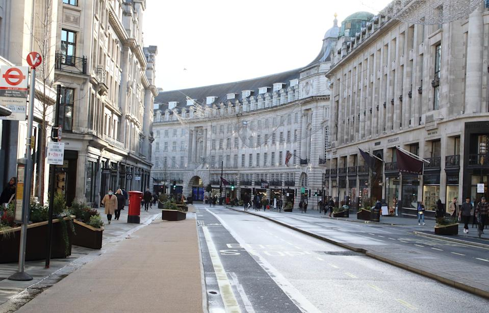 Only a handful of people in Regent Street despite it being closed to traffic. London enters Tier 4 severe restrictions as new Mutant Covid-19 strain is found. The new variant of the virus has been found to be 70\% more infectious and is currently rampant throughout London and the South East of England. (Photo by Keith Mayhew / SOPA Images/Sipa USA)