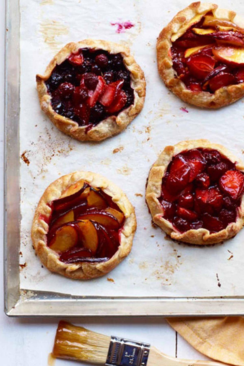 """<p>Strawberries pair up with other summer fruits in these scrumptious mini tarts.</p><p><em><a href=""""https://www.womansday.com/food-recipes/food-drinks/recipes/a12133/summer-fruit-tarts-recipe-wdy0712/"""" rel=""""nofollow noopener"""" target=""""_blank"""" data-ylk=""""slk:Get the recipe for Summer Fruit Tarts."""" class=""""link rapid-noclick-resp"""">Get the recipe for Summer Fruit Tarts.</a></em></p>"""