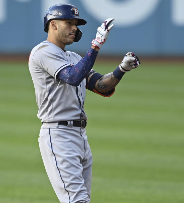 Houston Astros' Carlos Correa (1) celebrates after hitting an RBI-single in the first inning of a baseball game against the Cleveland Indians, July 3, 2021, in Cleveland. (AP Photo/David Dermer)