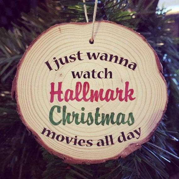 """<p>Christmastime is all about saying how you really feel, and nothing says that better than this handcrafted <a href=""""https://www.popsugar.com/buy/I-Just-Wanna-Watch-Hallmark-Movies-Wood-Slice-Christmas-Ornament-395682?p_name=I%20Just%20Wanna%20Watch%20Hallmark%20Movies%20Wood-Slice%20Christmas%20Ornament&retailer=etsy.com&pid=395682&price=10&evar1=buzz%3Aus&evar9=45555300&evar98=https%3A%2F%2Fwww.popsugar.com%2Fentertainment%2Fphoto-gallery%2F45555300%2Fimage%2F45555370%2FI-Just-Wanna-Watch-Hallmark-Movies-Wood-Slice-Christmas-Ornament&prop13=mobile&pdata=1"""" rel=""""nofollow"""" data-shoppable-link=""""1"""" target=""""_blank"""" class=""""ga-track"""" data-ga-category=""""Related"""" data-ga-label=""""http://www.etsy.com/listing/642485754/i-just-wanna-watch-hallmark-christmas?ga_order=most_relevant&amp;ga_search_type=all&amp;ga_view_type=gallery&amp;ga_search_query=hallmark&amp;ref=sr_gallery-2-2&amp;organic_search_click=1"""" data-ga-action=""""In-Line Links"""">I Just Wanna Watch Hallmark Movies Wood-Slice Christmas Ornament</a> ($10). </p>"""