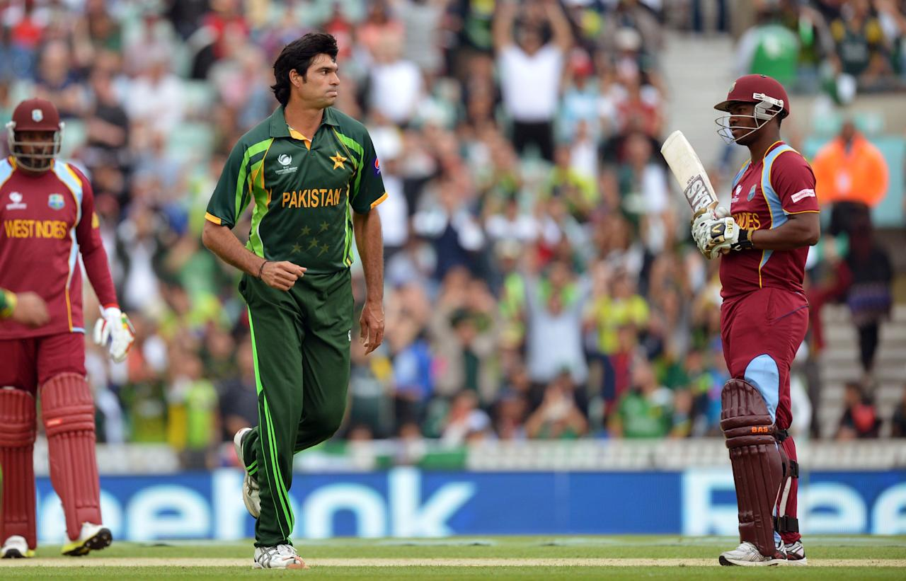 Pakistan's Mohammad Irfan (centre) celebrates taking the wicket of West Indies' Johnson Charles (right) during the ICC Champions Trophy match at The Oval, London.