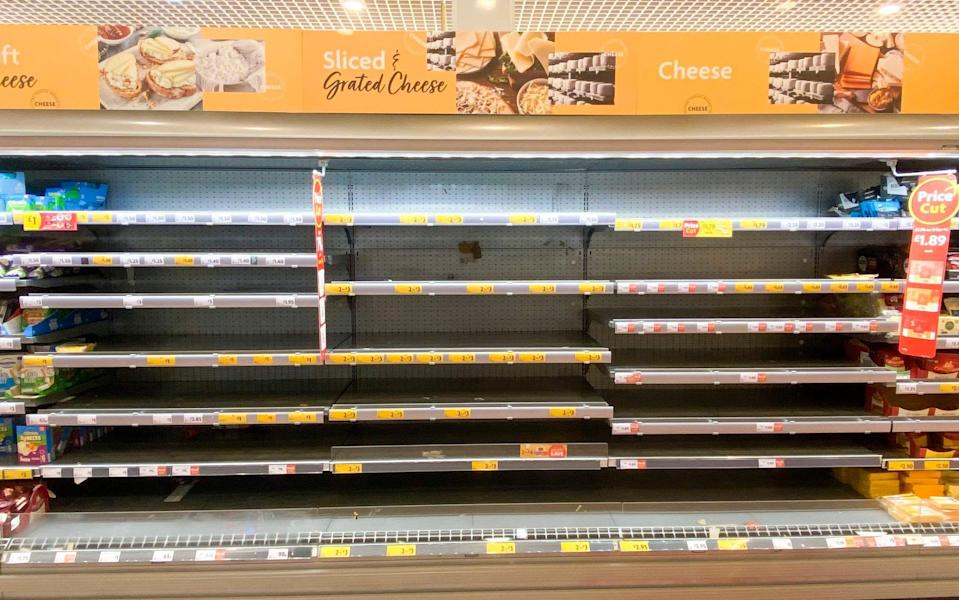 Sliced cheese shelves stand empty at a store in Edinburgh - Katielee Arrowsmith/SWNS