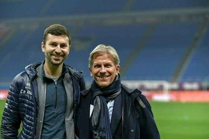 Parma's US owner Kyle J. Krause (R) and his son Tanner before a Serie A match against AC Milan in December 2020.