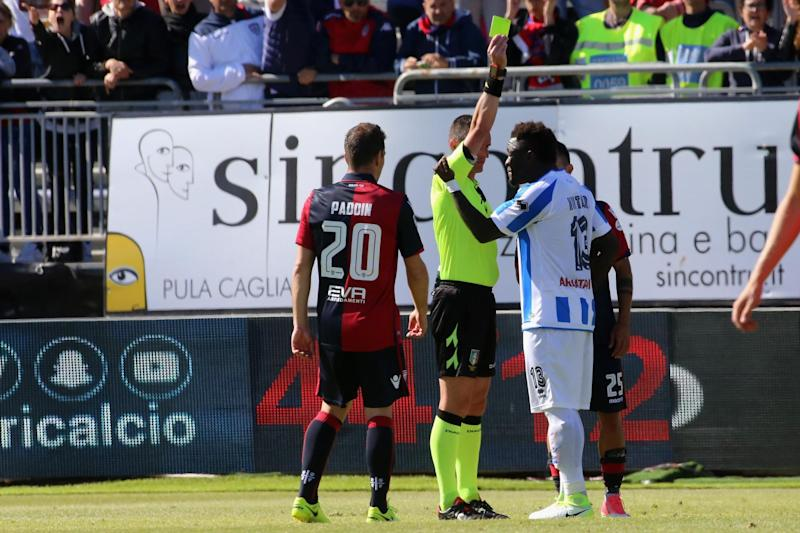 Muntari is booked in the 90th minute of Pescara's Serie A match at Cagliari: Getty Images