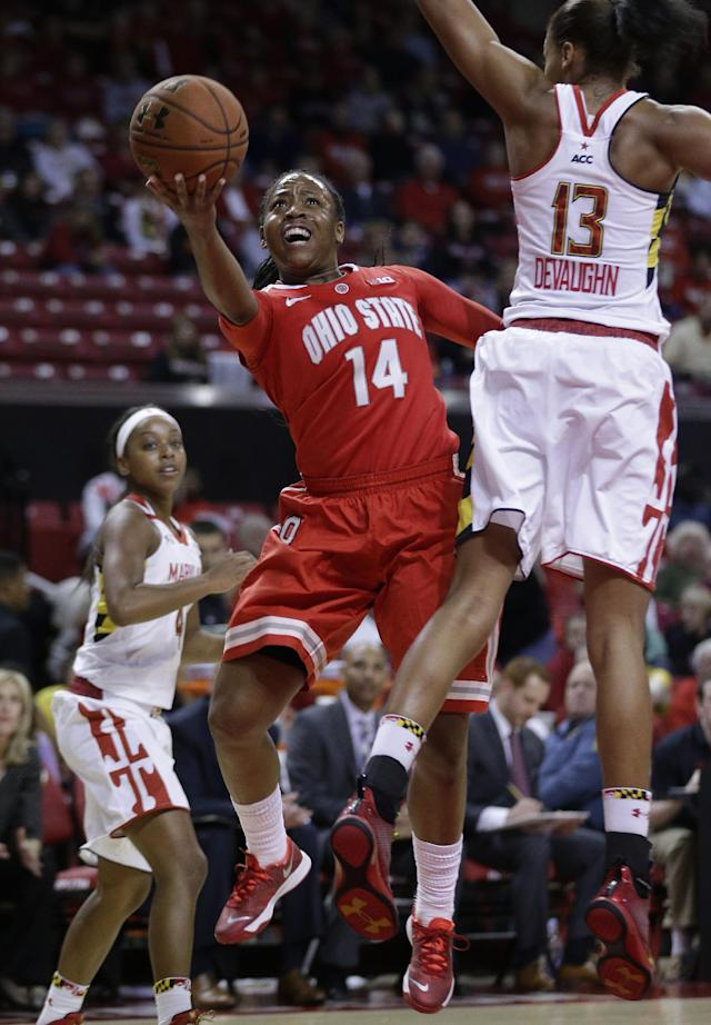 Ohio State guard Ameryst Alston (14) shoots between Maryland guard Lexie Brown, back, and center Alicia DeVaughn in the first half of an NCAA college basketball game in College Park, Md., Wednesday, Dec. 4, 2013. (AP Photo/Patrick Semansky)