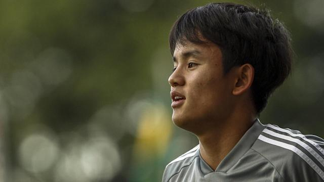 The Japan international says that he is adapting well to his new side