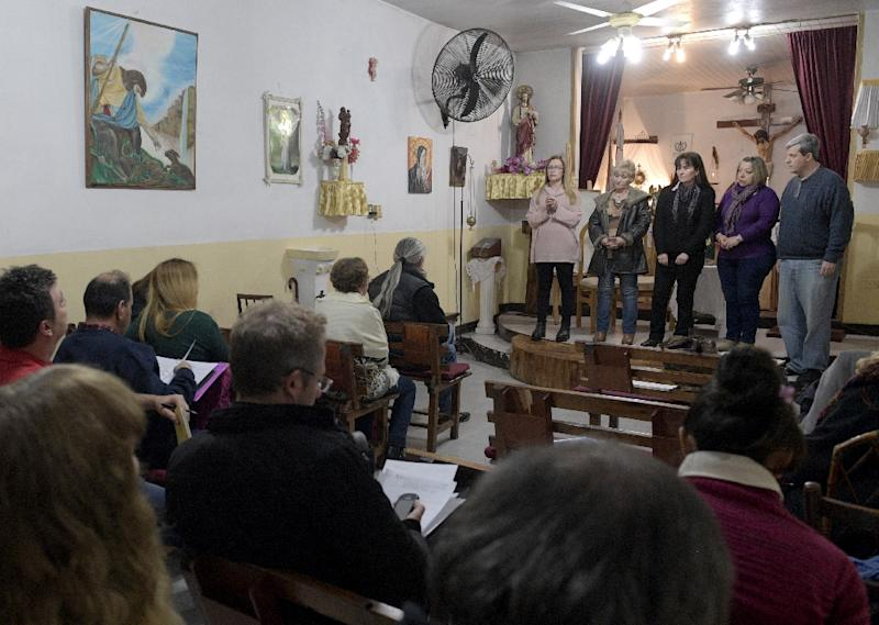 Students take an oral exam at the 'El Buen Pastor' parish in Santos Lugares, on the outskirts of Buenos Aires (AFP Photo/Juan Mabromata)