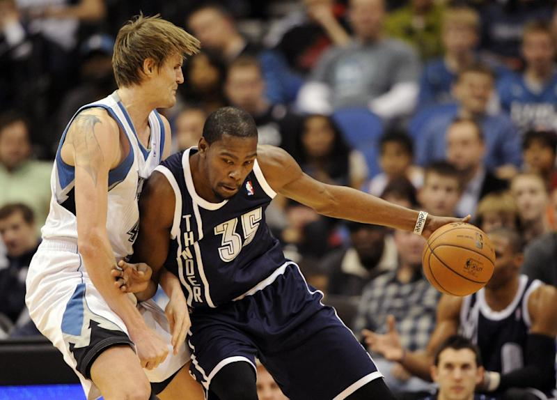 Minnesota Timberwolves' Andrei Kirilenko, left, of Russia, defends against Oklahoma City Thunder's Kevin Durant (35) during the first quarter of an NBA basketball game at the Target Center on Thursday, Dec. 20, 2012, in Minneapolis. (AP Photo/Hannah Foslien)