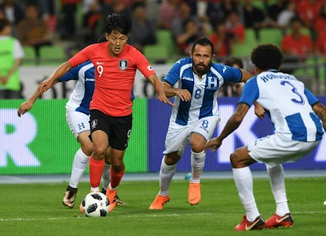 South Korea's Lee Seung-woo (L), who plays for Verona in Italy, was the surprise name retained in the final 23-man World Cup squad after making his debut just six days ago against Honduras