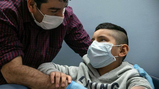 PHOTO: Guatemalan immigrant Marvin comforts his son Junior after a nurse drew blood for a COVID-19 antibody test at a clinic, May 5, 2020, in Stamford, Conn. (John Moore/Getty Images, FILE)