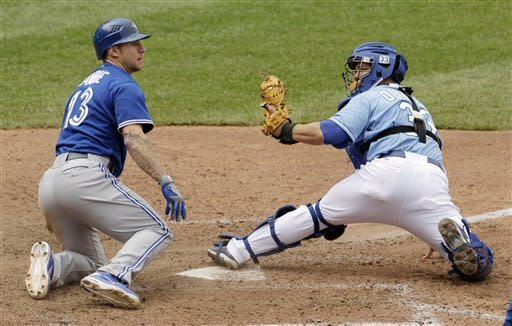 Toronto Blue Jays' Brett Lawrie beats the tag by Kansas City Royals catcher Humberto Quintero to steal home during the eighth inning of a baseball game, Sunday, April 22, 2012, in Kansas City, Mo. (AP Photo/Charlie Riedel)