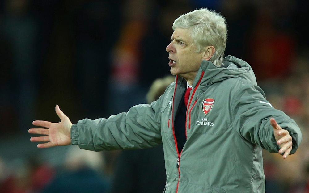 Arsenal's manager Arsene Wenger reacts to a decision by the referee during the English Premier League soccer match between Liverpool and Arsenal - Credit: AP