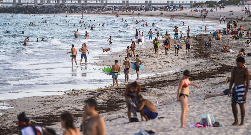 Pictured are hundreds of people on Miami Beach amid the coronavirus pandemic.