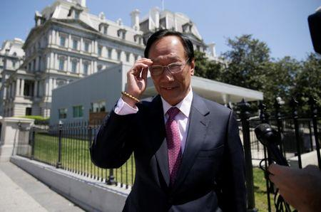 FILE PHOTO - Foxconn Chairman Terry Gou talks to reporters as he exits the White House following a second day of meetings in Washington, U.S. on April 28, 2017. REUTERS/Jim Bourg/File Photo