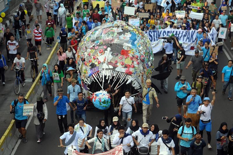 "Environmental activists during a demonstration ""plastic-free march"" on Car-free days in Jakarta, on July, 21,2019. (Photo by Dasril Roszandi/NurPhoto)"
