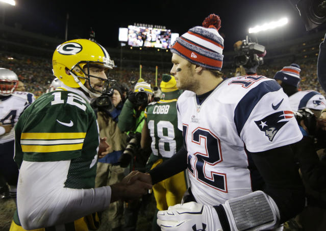 Tom Brady and Aaron Rodgers meet on the field after a 2014 game. (AP)