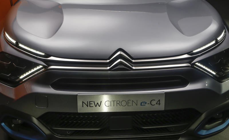 The Citroen e-C4 all electric hatchback is display during a media presentation in Paris, Tuesday, June 30, 2020. PSA Group's Citroen Brand is showing off a new version of its C4 compact hatchback, a model that will be key to the company's sales prospects as it faces a highly competitive European car market that faces severe headwinds from the coronavirus. (AP Photo/Michel Euler)