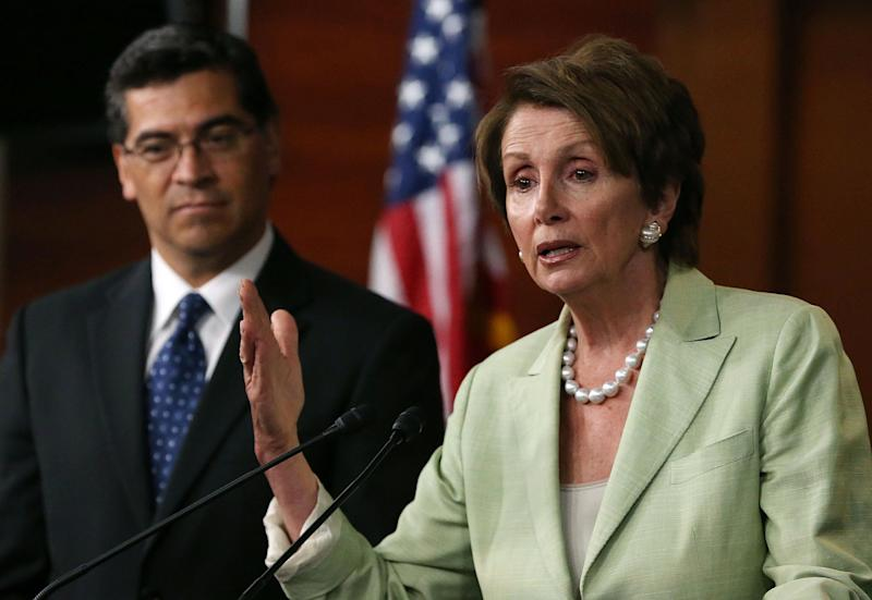 House Minority Leader Nancy Pelosi (D-CA) (R) speaks to the media with Rep. Xavier Becerra (D-CA) after a meeting with President Barack Obama on Capitol Hill, July 31, 2013 in Washington, D.C. (Photo by Mark Wilson/Getty Images)