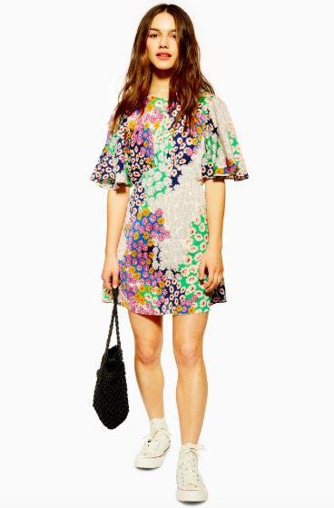 """<p><a class=""""body-btn-link"""" href=""""https://www.topshop.com/en/tsuk/product/new-in-this-week-2169932/new-in-fashion-6367514/petite-austin-floral-print-angel-sleeve-mini-dress-8633475"""" target=""""_blank"""">SHOP NOW</a> £28.00 with student discount</p>"""