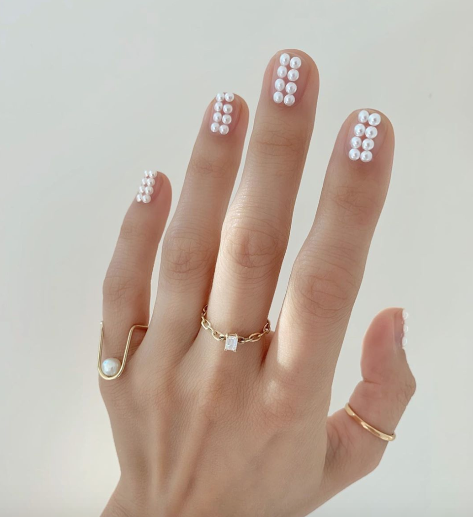"It's not hard to see why <a href=""https://www.glamour.com/story/pearl-nail-art-ideas?mbid=synd_yahoo_rss"" rel=""nofollow noopener"" target=""_blank"" data-ylk=""slk:pearl nails"" class=""link rapid-noclick-resp"">pearl nails</a> are everywhere this fall. They're instantly both pretty and cool without trying. Match them to your <a href=""https://www.glamour.com/story/best-pearl-hair-clips?mbid=synd_yahoo_rss"" rel=""nofollow noopener"" target=""_blank"" data-ylk=""slk:hair clip"" class=""link rapid-noclick-resp"">hair clip</a> for a full <em>lewk.</em>"