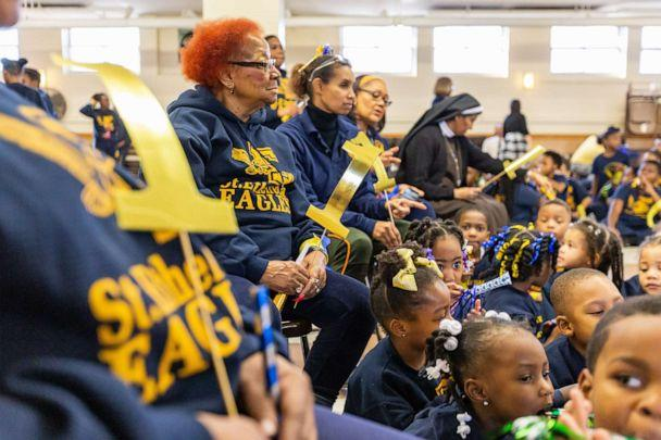 PHOTO: Family, friends, and community members cheer on the students of St. Ethelreda School during their pep rally. (Denise Duriga)