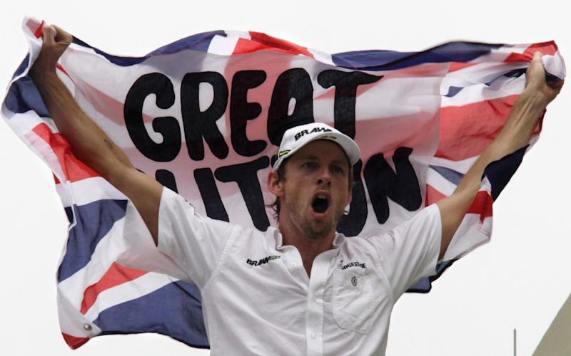 Brawn GP Formula One driver Jenson Button of Britain celebrates becoming the 2009 Formula One World Champion after finishing fifth in the Brazilian F1 Grand Prix at the Interlagos racetrack in Sao Paulo October 18, 2009. REUTERS/Bruno Domingos (BRAZIL SPORT MOTOR RACING IMAGES OF THE DAY)  - Credit: BRUNO DOMINGOS/Reuters