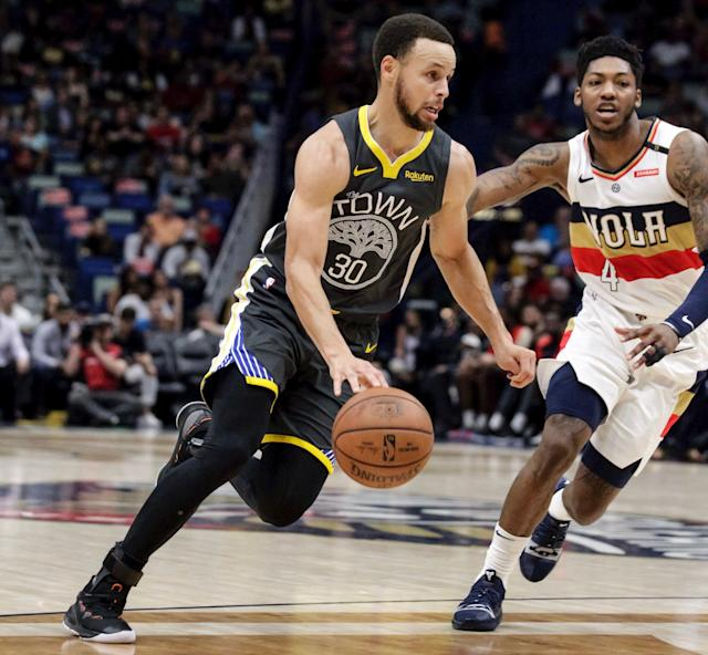 Stephen Curry did not return after suffering a sprained foot against the Pelicans. (AP)