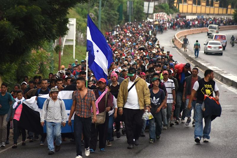 "A ""caravan"" of Honduran migrants crossing into Guatemala on their march to the United States, on October 17, 2018"